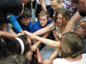 Team 6 working together to untie the human knot