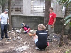 Jonathan, Tasha, Morgan, and Caleb picking up trash