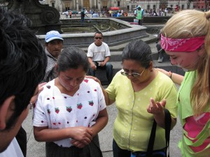 Zoe praying with women in Central park